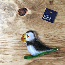 Load image into Gallery viewer, Black and White Glass Puffin Ornament with Green Glass Sled