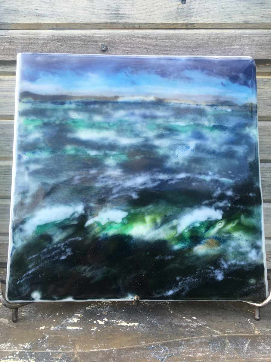 Landscape palette knife painting created from glass powders. The scene is of a turbulent ocean.