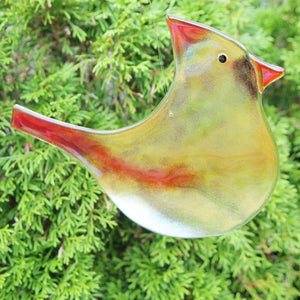 Large Amber and Flame Red Glass Cardinal Bird hanging ornament with cedar tree in the background
