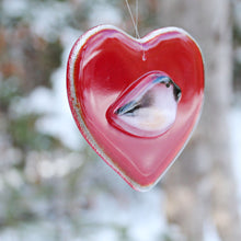 Load image into Gallery viewer, A smooth glossy red glass heart with a chickadee bird on the front