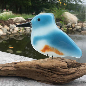 Blue White and Tan Glass Kingfisher Bird sits on Driftwood