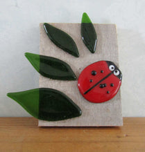 Load image into Gallery viewer, Glass ladybird and leaves on barn wood