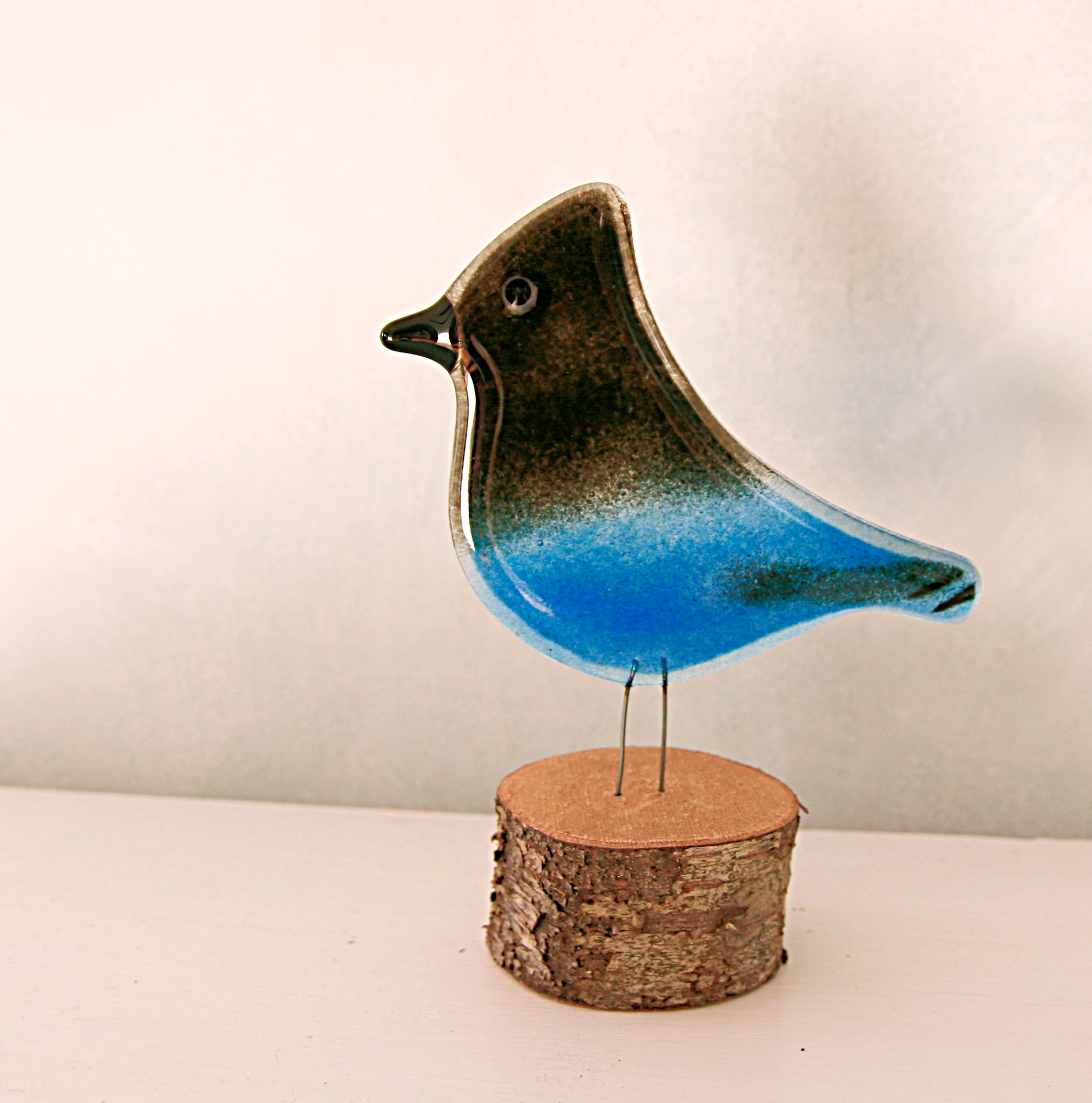 Steller's Jay bird ornament by The Glass Bakery Ltd