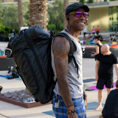 Dray Gardner from silent savasana wearing the mantisyoga retreat duffel backpack