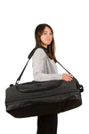 retreat duffel pack in use with shoulder strap woman