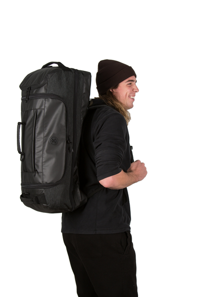 retreat duffel pack side view with backpack straps on