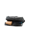 retreat duffel pack slightly open with yoga mat and yoga gear in base