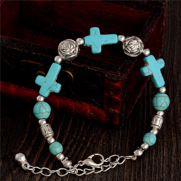 Beautiful natural stone bracelet in the shape of a Tibetan green cross