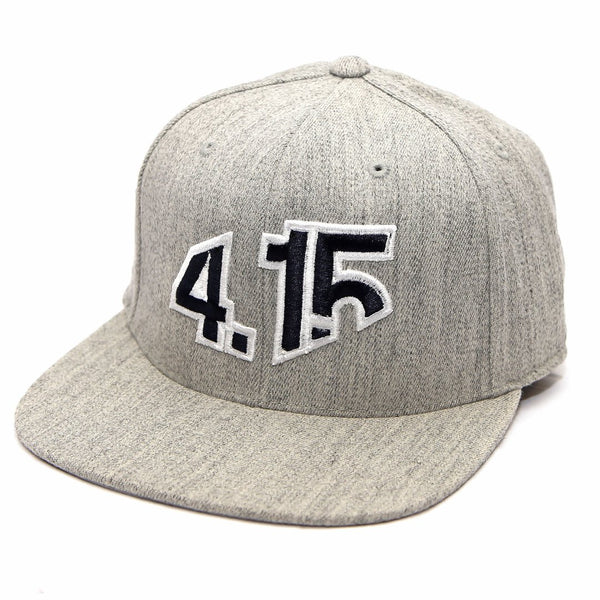 Heather Gray Snapback Cap with with raised 3D embroidered 4.15 logo on front in Navy Blue thread color