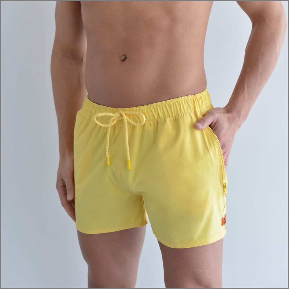 SegSea Short swim trunks, yellow with patterned back pocket,