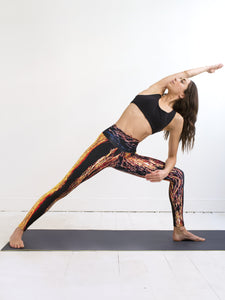 Naxos | Efesto Designs yoga leggings | inspiration from sea waves, yellow/orange/blue/black | extended side angle yoga position