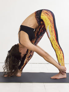 Naxos | Efesto Designs yoga leggings | inspiration from sea waves, yellow/orange/blue/black | downward facing dog yoga position