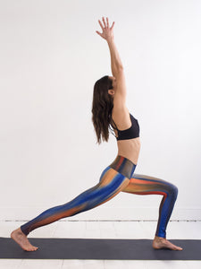 Jet | Efesto Designs yoga leggings | Jet engine flame inspired colours and shapes, blue/orange/red | crescent lunge yoga position