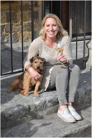 Camilla enjoying a glass of wine with her dog outside Somerset Wines