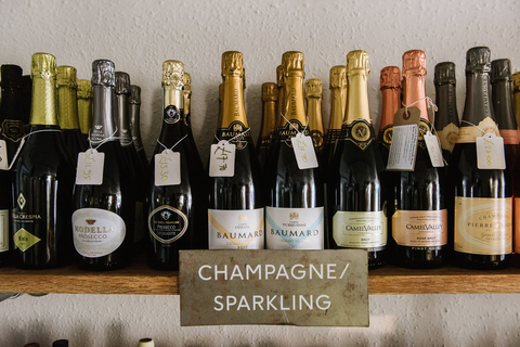 A selection of bottled champagne and sparkling wine on a shelf in Somerset wines