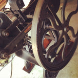 old style printing press wheel