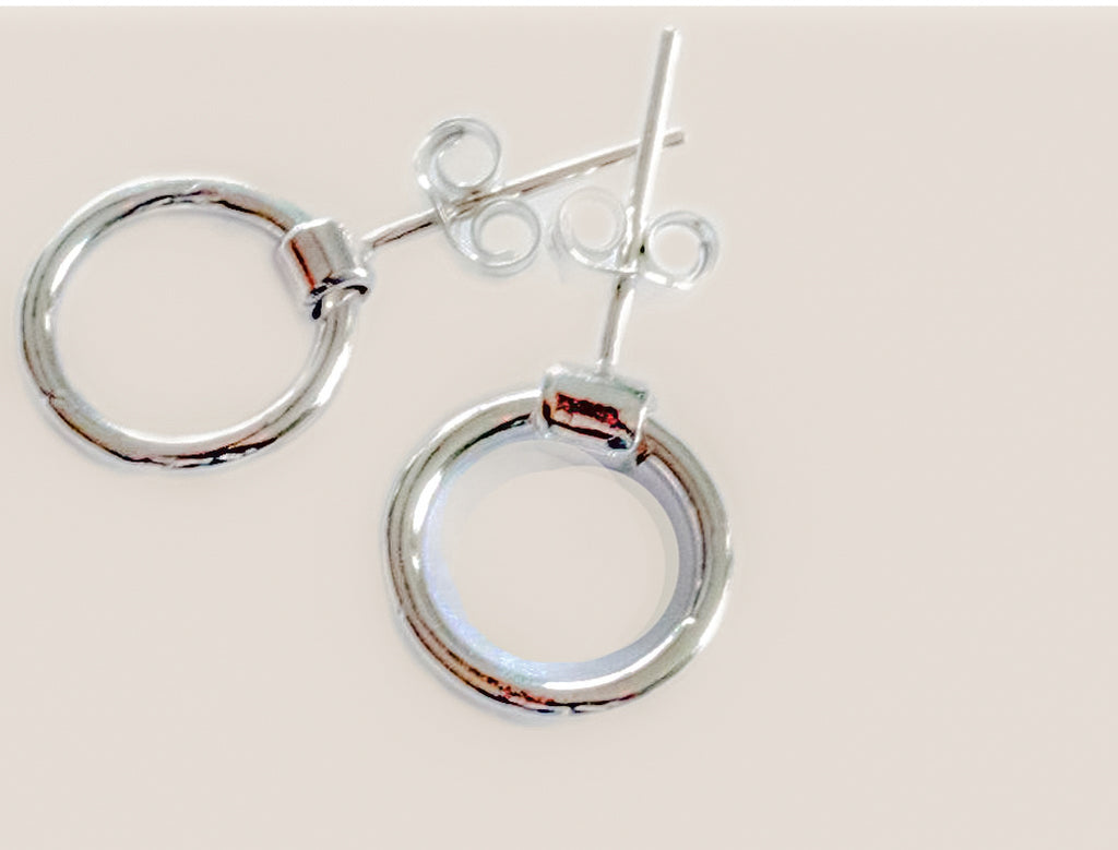 8mm in width and 1.5mm thick, these sterling silver earrings swing as you move, with tiny butterfly backs.