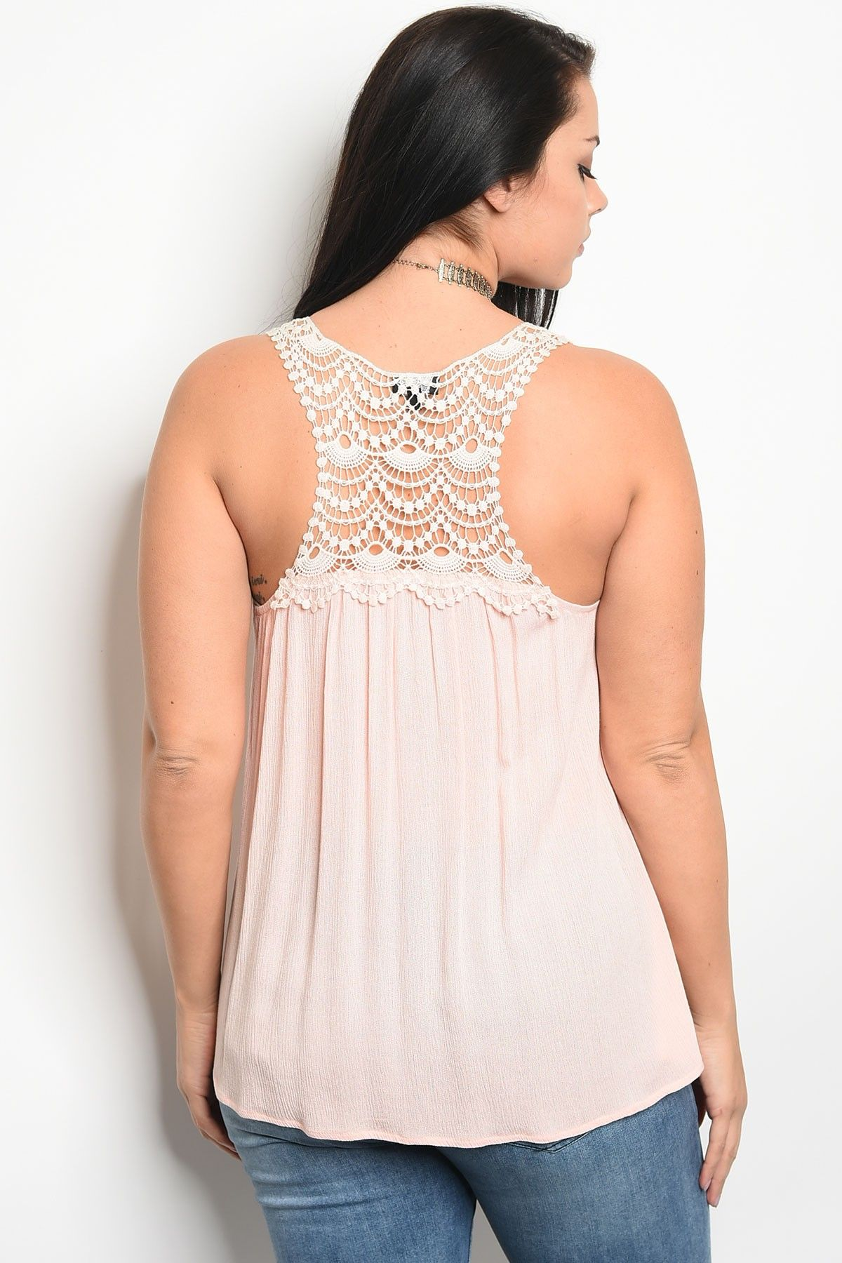 Ladies fashion plus size sleeveless top that features a v neckline and lace details