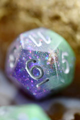 Cosmic Seas - Gold and Holographic Flake Acrylic Dice Set - GAMETEEUK