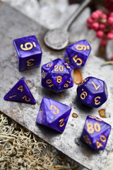 Thaumaturgy - Purple Ribbon Lustre-Sheen Acrylic Dice Set - GAMETEEUK