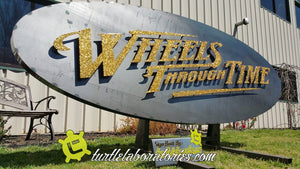 Wheels Through Time Sign