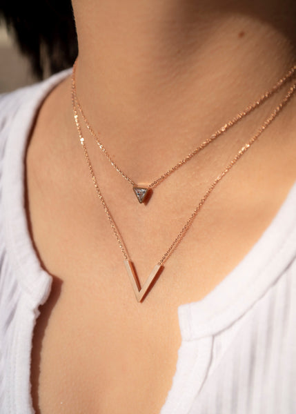 gold double layering necklace with diamonds