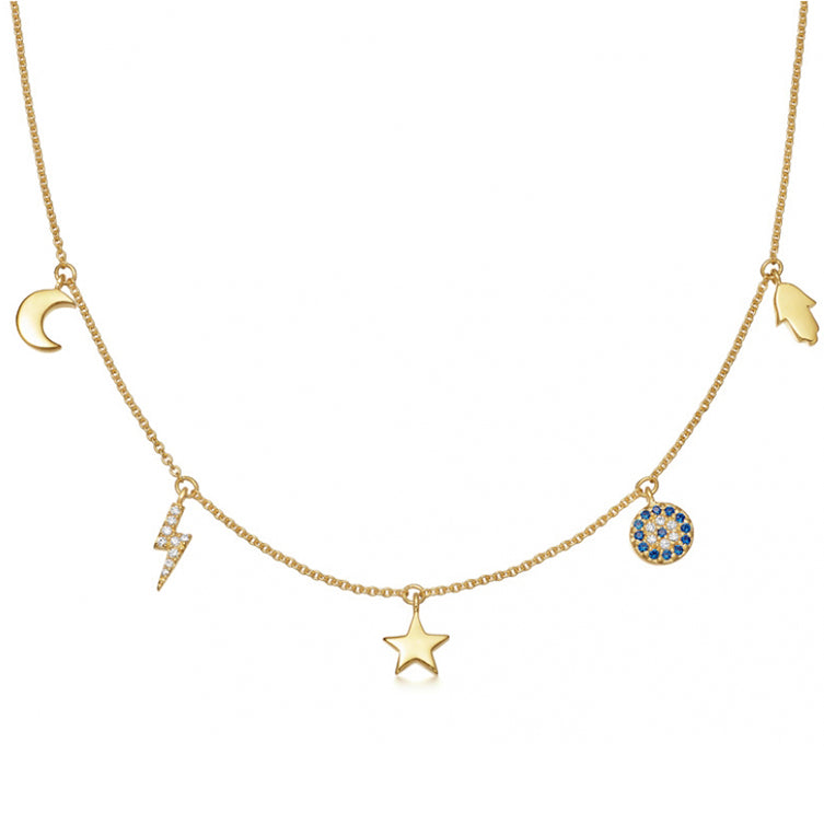 delicate gold layering necklace with moon and stars celestial symbols