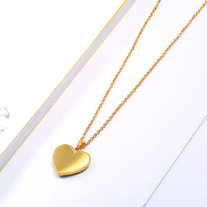gold locklet heart necklace  jewelry on gold chain