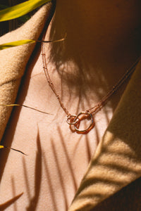 gold interlocking eternity infinity necklace charm 18k circles charm