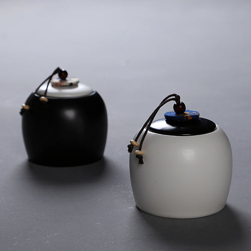 Round Ceramic Storage Tea Jar with Ornate Cord Lid - Ivory & Matte Black