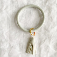 Light grey keychain bracelet with tassel