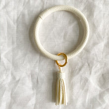 White keychain bracelet with tassel
