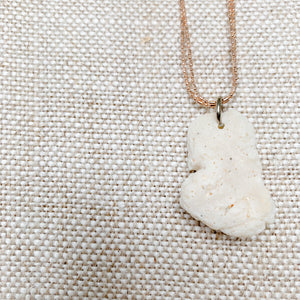 Closeup white coral charm sustainable fashion item