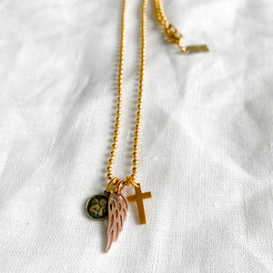 Wing cross angelface charm necklace on gold ball chain