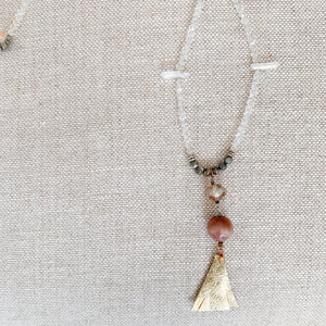 Crystal quartz raw pyrite chain gold leather tassel necklace