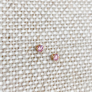 Light pink crystal cubic zirconia set in gold post earrings
