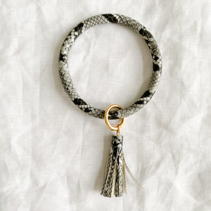 Black and white snakeskin keychain bracelet with tassel