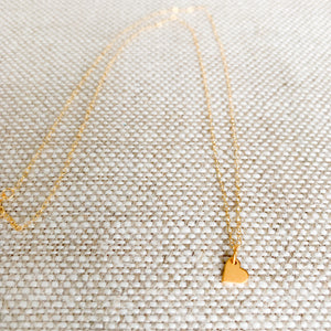 Gold mini heart charm necklace