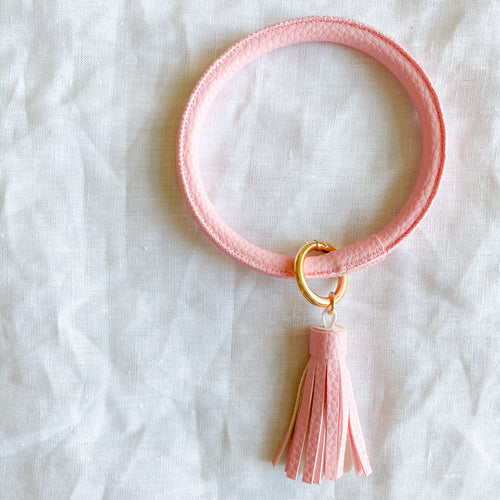 Light pink keychain bracelet with tassel