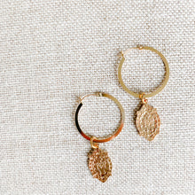 Gold two inch hoops with ave Maria charms