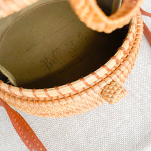 Bow rattan Bali bag with sun design leather strap