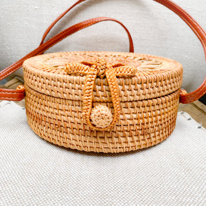 Bow rattan Bali bag with sun design leather strap Bow detail