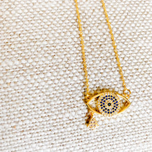 Gold evil eye necklace with hamsa hand