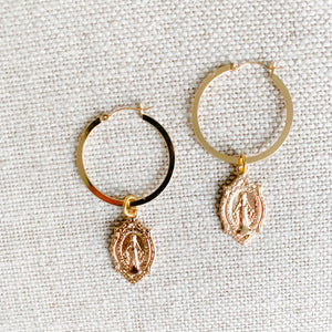 Gold 2 inch hoops with ave Maria charms