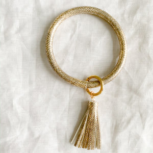 Gold keychain bracelet with tassel