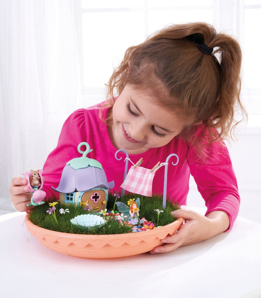 girl playing with my fairy garden toy from brightminds