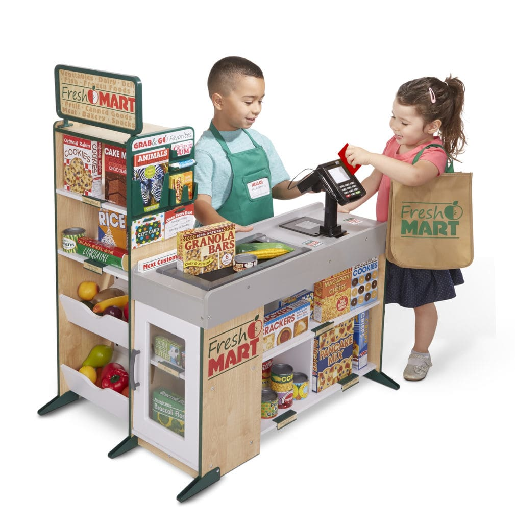 boy and girl playing with melissa doug fresh mart accessorised