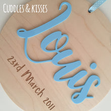 Wooden disc with acrylic name and engraved date of birth