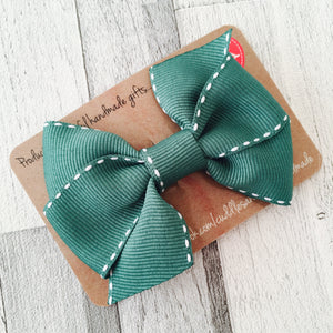 Saddle stitched hair bow