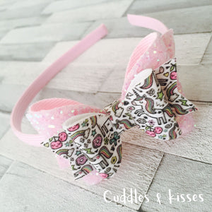 Cute baby pink unicorn bow